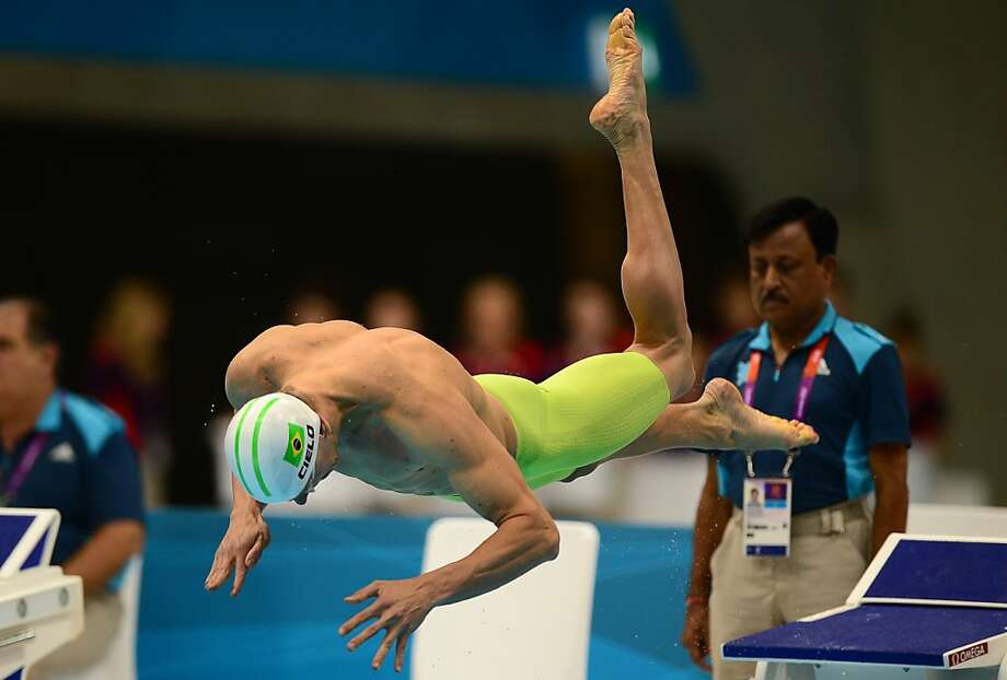 TOPSHOTS Brazil's Cesar Cielo dives as he competes in the men's 100m freestyle heats during the swimming event at the London 2012 Olympic Games on July 31, 2012 in London.  AFP PHOTO / MARTIN BUREAUMARTIN BUREAU/AFP/GettyImages Photo: Martin Bureau, AFP/Getty Images