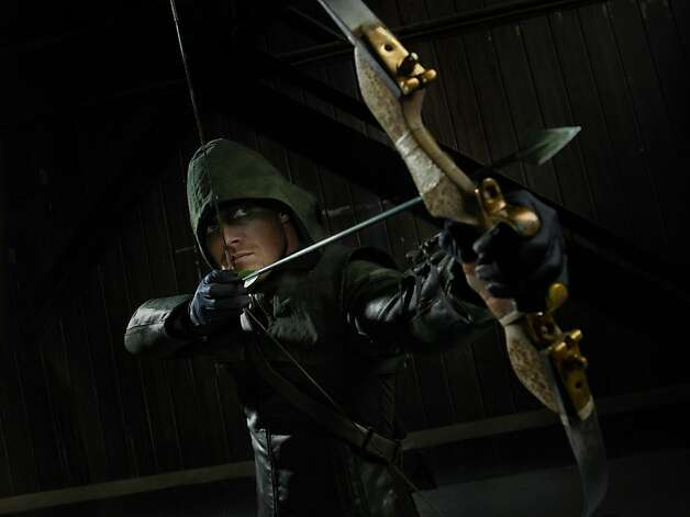 "In the action-packed ""Arrow,"" Stephen Amell plays a rescued rich kid as well as his green-hooded alter ego. Photo: Kharen Hill, The CW"