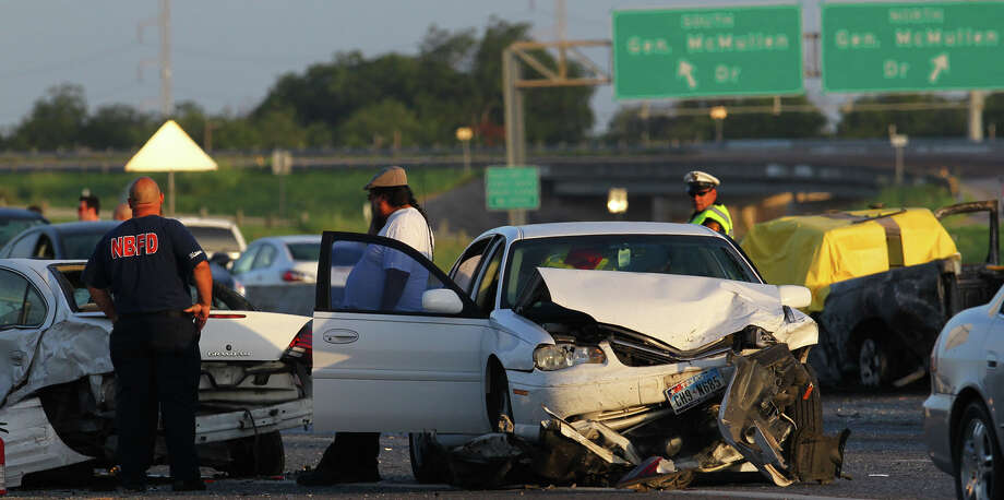 Texas is recording a reduction in traffic fatalities, but the state's drivers have more work to do to ensure safety on the road.  This fatal accident occured  last month on  Highway 90. Photo: John Davenport, San Antonio Express-News / SAN ANTONIO EXPRESS-NEWS