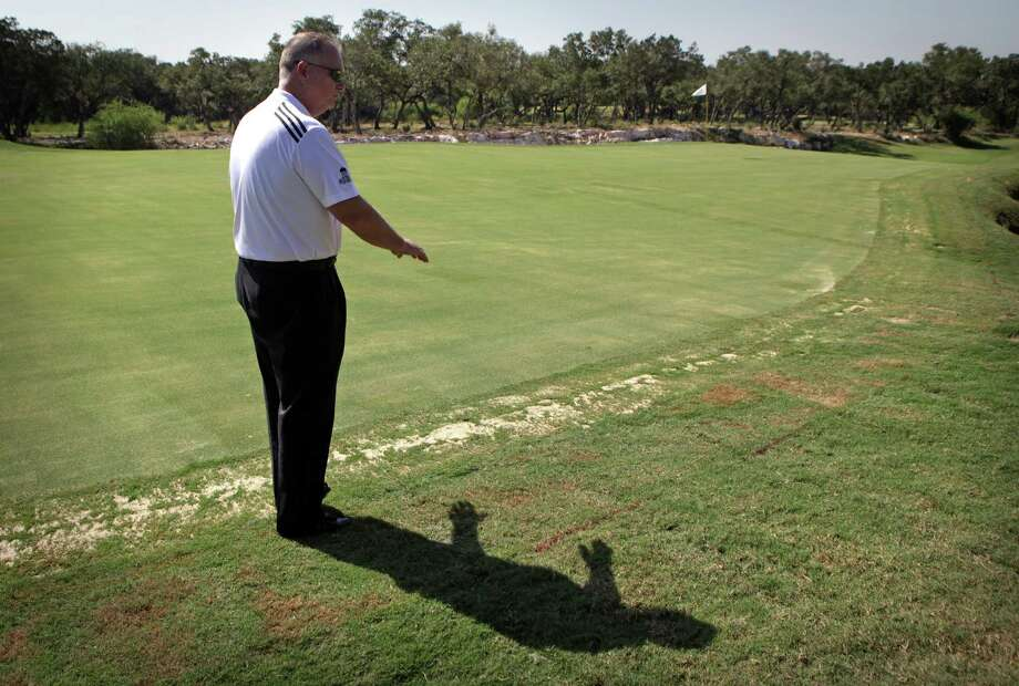 Jimmy Terry, general manager of TPC San Antonio, shows the slope changes made to the No. 12 green. The entire green was lowered to make the flag and locations more visible from the fairway. Photo: BOB OWEN, San Antonio Express-News / © 2012 San Antonio Express-News