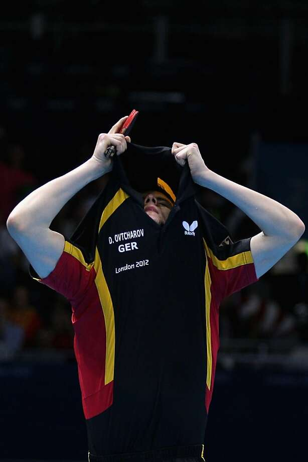 LONDON, ENGLAND - JULY 31:  Dimitrij Ovtcharov of Germany celebrates winning the Men's Singles Table Tennis quarter-final match against Michael Maze of Denmark on Day 4 of the London 2012 Olympic Games at ExCeL on July 31, 2012 in London, England.  (Photo by Feng Li/Getty Images) Photo: Feng Li, Getty Images