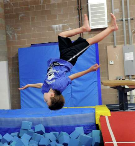 Vasi Cioana, Jr., 7, does a somersault at Vasi's Gymnastics Tuesday, july 31, 2012. Photo: Carol Kaliff
