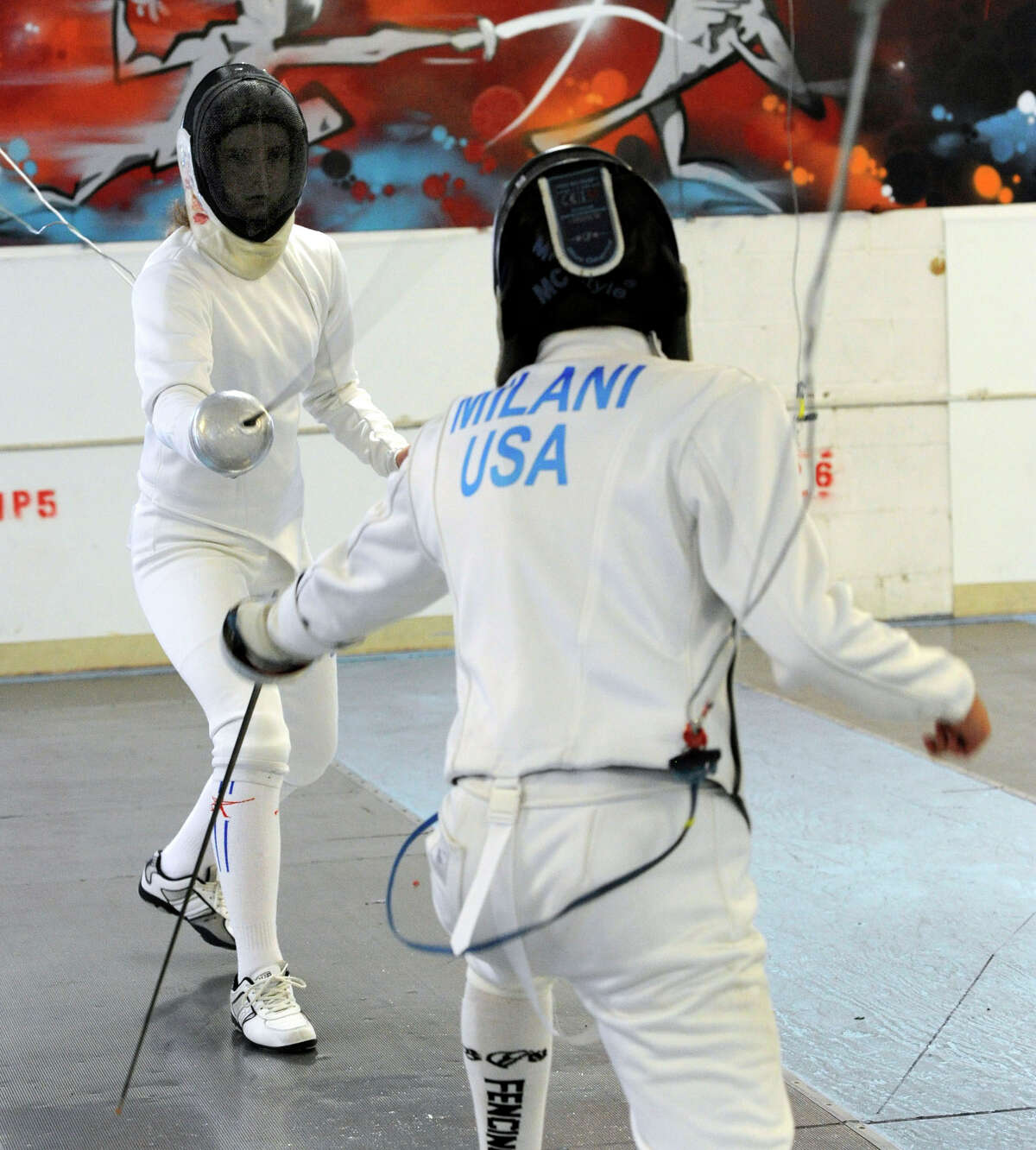 Lyric Lott, 13, left, of Roxbury, and Greg Milani, 15, of Brewster, N.Y., fence at the Candlewood Fencing Center in Danbury, Monday, July 30, 2012.