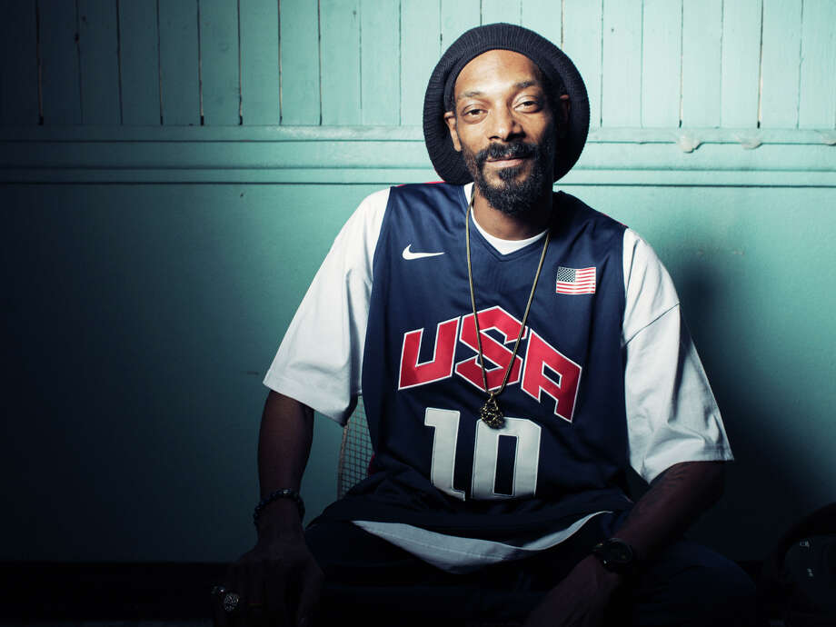 """This Monday, July 30, 2012 photo shows Snoop Dogg, who now goes by Snoop Lion, posing for a portrait at Miss Lily's in New York. Snoop Dogg says he was """"born again"""" during a visit to Jamaica in February, changed his name to Snoop Lion and is ready to make music that his """"kids and grandparents can listen to.""""  The artist known for gangster rap is releasing a reggae album called """"Reincarnated"""" in the fall. Photo: Victoria Will, VICTORIA WILL/INVISION/AP / Invision"""