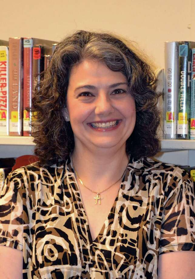 City resident Michelle Capozzella has been named the new director of Danbury Public Library. Capozzella has a career in library services that spans more than three decades including the past three years as assistant director of the library. Photo: Contributed Photo