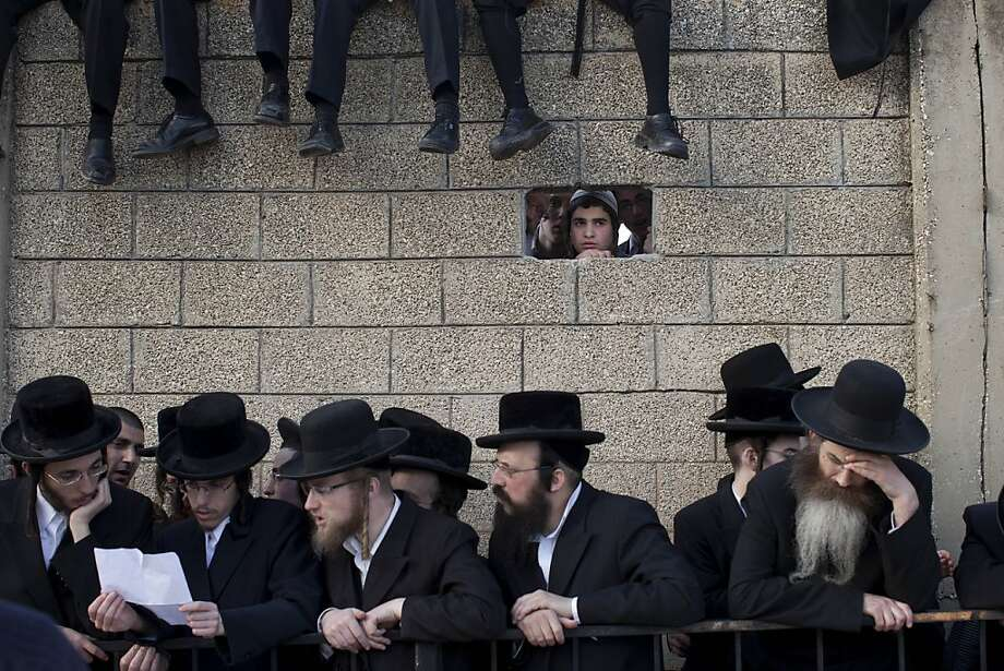 FILE - In this  March 14, 2012 file photograph, Ultra Orthodox Jews attend the funeral of Rabbi Moshe Yehoshua Hager, leader of the hassidic sect Vizhnitz in Israel, in Bnei Brak , Ultra Orthodox Jewish town near Tel Aviv, Israel. Ehud Barak, Israel's defense minister instructed the military on Tuesday to start drafting ultra-Orthodox Jewish men as it does other Israelis, setting up a potential clash over an issue that has divided the country for decades.. (AP Photo/Oded Balilty, File) Photo: Oded Balilty, Associated Press