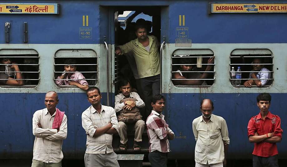 Indian stranded passengers wait for the train services to resume following a power outage in New Delhi, India, Tuesday, July 31, 2012. India's energy crisis cascaded over half the country Tuesday when three of its regional grids collapsed, leaving 620 million people without government-supplied electricity for several hours in, by far, the world's biggest blackout. Hundreds of trains stalled across the country and traffic lights went out, causing widespread traffic jams in New Delhi. (AP Photo/Kevin Frayer) Photo: Kevin Frayer, Associated Press