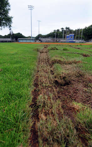 Some of the damage done to the football field at Nolan Field, which was suspected to have been done with an ATV, in Ansonia, Conn. on Tuesday July 31, 2012. Photo: Christian Abraham / Connecticut Post