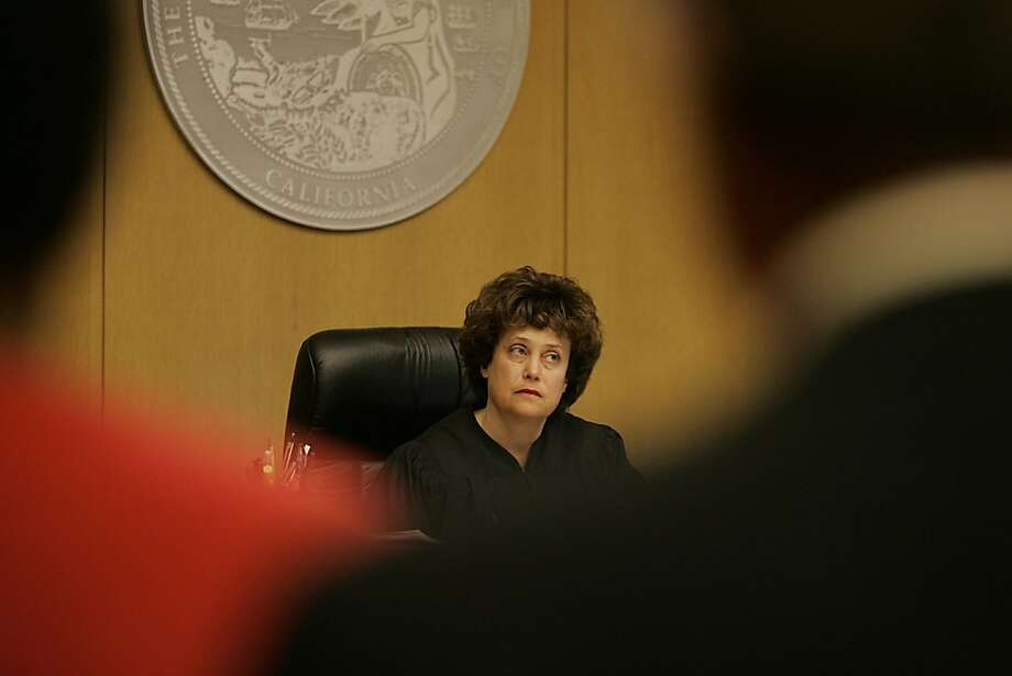 Judge Donna Little listens in Department 12 during the appearance of O'Neal, Brown, Boudreaux and Jones. Richard O'Neal, Richard Brown, Ray Boudreaux and Henry Watson Jones appear before Donna Little, Dept. 12 at the Hall of Justice on Monday, January 29, 2007.    Photo by Lea Suzuki/The San Francisco Chronicle Photo taken on 1/29/07, in San Francisco, CA.  **(themselves) cq.  39546 Photo: Lea Suzuki, SFC