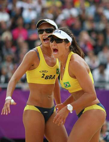 LONDON, ENGLAND - JULY 31:  Talita Rocha and Maria Antonelli of Brazil react during the Women's Beach Volleyball Preliminary match between Brazil and Germany on Day 4 at Horse Guards Parade on July 31, 2012 in London, England.  (Photo by Ryan Pierse/Getty Images) Photo: Ryan Pierse, Getty Images / 2012 Getty Images