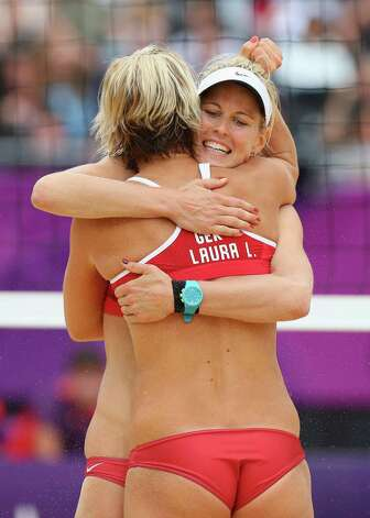 LONDON, ENGLAND - JULY 31:  Laura Ludwig hugs team mate Sara Goller of Germany after winning a point  during the Women's Beach Volleyball Preliminary match between Brazil and Germany on Day 4 at Horse Guards Parade on July 31, 2012 in London, England.  (Photo by Ryan Pierse/Getty Images) Photo: Ryan Pierse, Getty Images / 2012 Getty Images