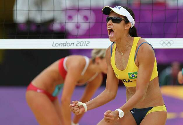 LONDON, ENGLAND - JULY 31:  Talita Rocha of Brazil  celebrates during the Women's Beach Volleyball Preliminary match between Brazil and Germany on Day 4 at Horse Guards Parade on July 31, 2012 in London, England.  (Photo by Ryan Pierse/Getty Images) Photo: Ryan Pierse, Getty Images / 2012 Getty Images