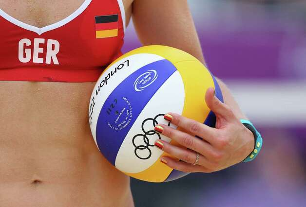LONDON, ENGLAND - JULY 31:  Laura Ludwig of Germany  holds the ball during the Women's Beach Volleyball Preliminary match between Brazil and Germany on Day 4 at Horse Guards Parade on July 31, 2012 in London, England.  (Photo by Ryan Pierse/Getty Images) Photo: Ryan Pierse, Getty Images / 2012 Getty Images