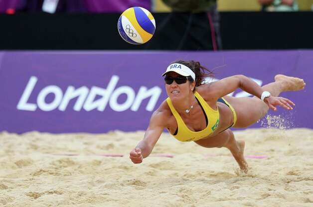 LONDON, ENGLAND - JULY 31:  Maria Antonelli of Brazil dives for a shot during the Women's Beach Volleyball Preliminary match between Brazil and Germany on Day 4 at Horse Guards Parade on July 31, 2012 in London, England.  (Photo by Ryan Pierse/Getty Images) Photo: Ryan Pierse, Getty Images / 2012 Getty Images