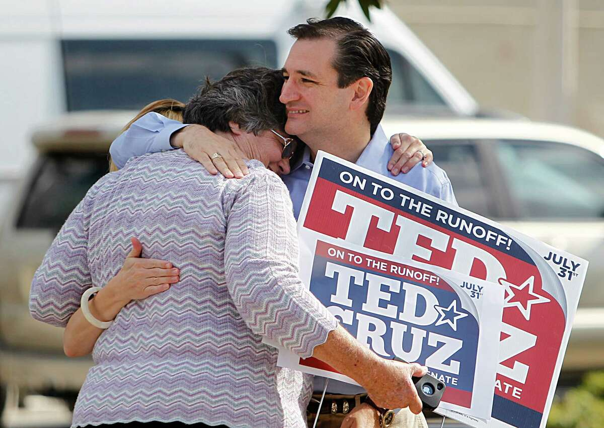 Maggie Wright, 66, is embraced by Ted Cruz, Republican candidate for U.S. Senate, while he visits supporters and voters at St. Martin's Episcopal Church on Tuesday, July 31, 2012, in Houston.