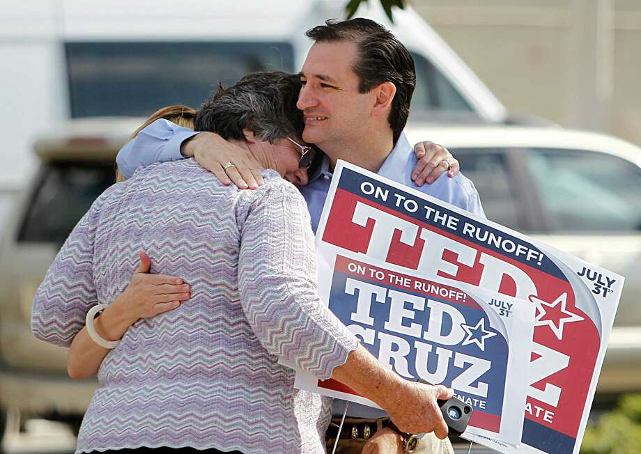 Maggie Wright, 66, is embraced by Ted Cruz, Republican candidate for U.S. Senate, while he visits supporters and voters at St. Martin's Episcopal Church on Tuesday, July 31, 2012, in Houston. Photo: Mayra Beltran, Houston Chronicle / © 2012 Houston Chronicle