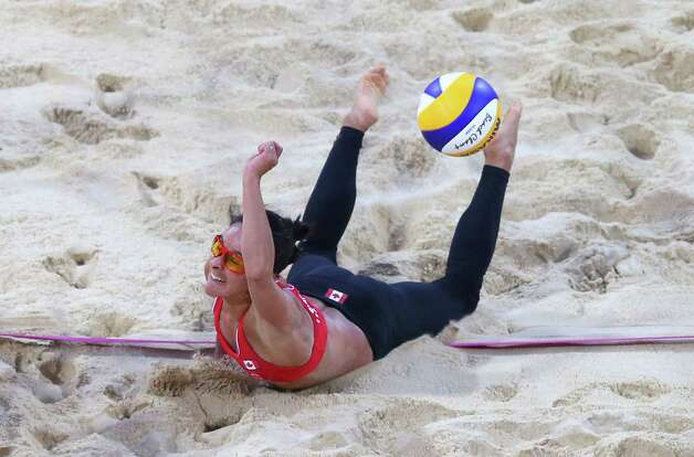 LONDON, ENGLAND - JULY 31:  Marie-Andree Lessard of Canada dives for a shot during the Women's Beach Volleyball Preliminary match between Canada and Russia on Day 4 at Horse Guards Parade on July 31, 2012 in London, England.  (Photo by Ryan Pierse/Getty Images) Photo: Ryan Pierse, Getty Images / 2012 Getty Images