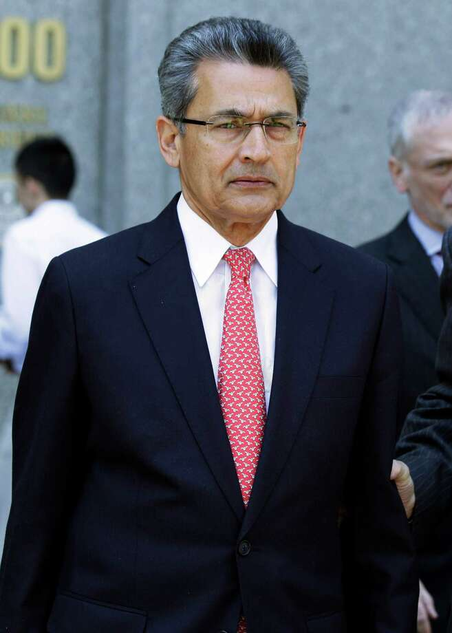 Former Goldman Sachs director Rajat Gupta leaves federal court in New York June 15, 2012. Gupta, accused of feeding confidential information to a corrupt hedge fund manager, was convicted of conspiracy and three counts of securities fraud. (AP Photo/Richard Drew) Photo: Richard Drew, Associated Press / AP