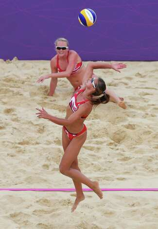 LONDON, ENGLAND - JULY 31:  Zara Dampney of Great Britain reaches for a shot during the Women's Beach Volleyball Preliminary match between Great Britain and Italy on Day 4 at Horse Guards Parade on July 31, 2012 in London, England.  (Photo by Ryan Pierse/Getty Images) Photo: Ryan Pierse, Getty Images / 2012 Getty Images