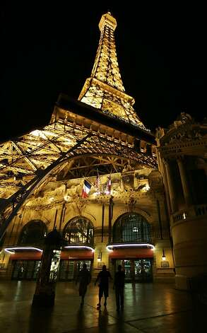 Tourists walk under the replica of the Eiffel Tower at Paris Hotel and Casino on the Las Vegas Strip. Photo: Laura Rauch, AP