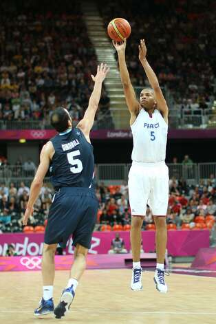Nicolas Batum #5 of France shoots a three pointer in the Men's Basketball Preliminary Round match between France and Argentina on Day 4 of the London 2012 Olympic Games at Basketball Arena on July 31, 2012 in London, England. (Christian Petersen / Getty Images)