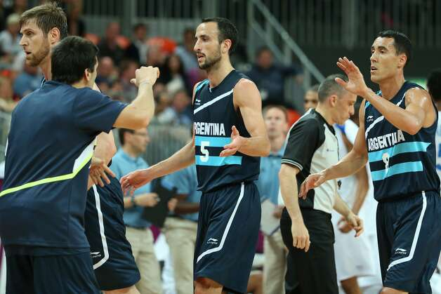 Manu Ginobili #5 of Argentina walks off court during a quarter break in the Men's Basketball Preliminary Round match between France and Argentina on Day 4 of the London 2012 Olympic Games at Basketball Arena on July 31, 2012 in London, England. (Christian Petersen / Getty Images)