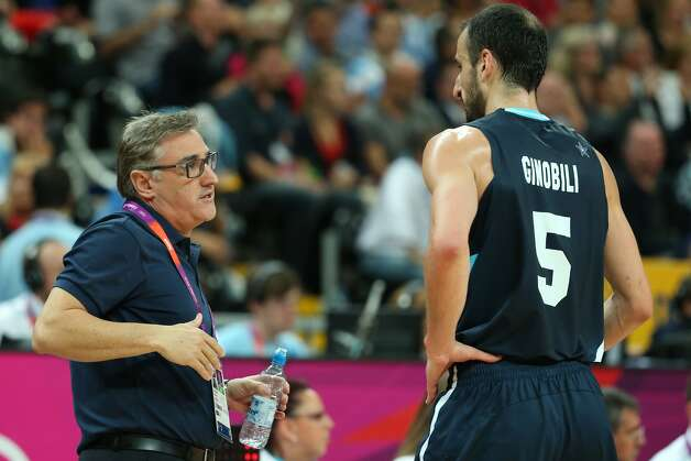 Manu Ginobili #5 of Argentina speaks with the team coach Julio Lamas in the Men's Basketball Preliminary Round match between France and Argentina on Day 4 of the London 2012 Olympic Games at Basketball Arena on July 31, 2012 in London, England. (Christian Petersen / Getty Images)