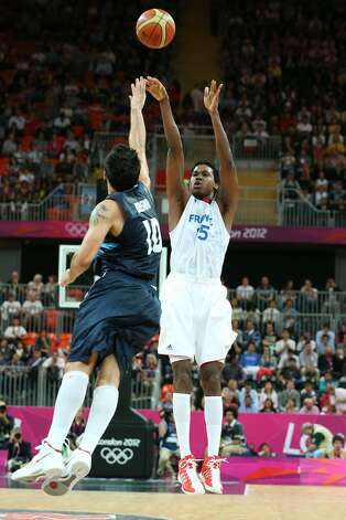 Mickael Gelabale #15 of France takes a jump shot in the Men's Basketball Preliminary Round match between France and Argentina on Day 4 of the London 2012 Olympic Games at Basketball Arena on July 31, 2012 in London, England. (Christian Petersen / Getty Images)