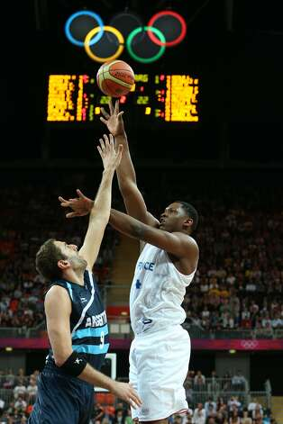 Kevin Seraphin #4 of France puts up a shot in the Men's Basketball Preliminary Round match between France and Argentina on Day 4 of the London 2012 Olympic Games at Basketball Arena on July 31, 2012 in London, England. (Christian Petersen / Getty Images)