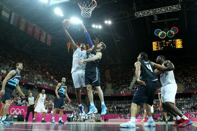 Boris Diaw #13 of France lays up over Andres Nocioni #13 of Argentina in the Men's Basketball Preliminary Round match between France and Argentina on Day 4 of the London 2012 Olympic Games at Basketball Arena on July 31, 2012 in London, England. (Christian Petersen / Getty Images)