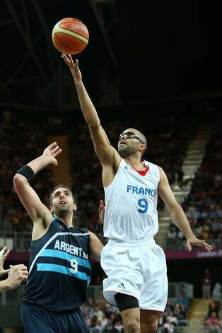 Tony Parker #9 of France lays up over Juan Gutierrez #9 of Argentina in the Men's Basketball Preliminary Round match between France and Argentina on Day 4 of the London 2012 Olympic Games at Basketball Arena on July 31, 2012 in London, England. (Christian Petersen / Getty Images)