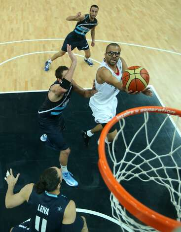 Tony Parker #9 of France lays up in the Men's Basketball Preliminary Round match between France and Argentina on Day 4 of the London 2012 Olympic Games at Basketball Arena on July 31, 2012 in London, England. (Christian Petersen / Getty Images)
