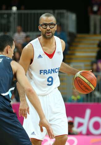 Tony Parker #9 of France dribbles the ball in the Men's Basketball Preliminary Round match between France and Argentina on Day 4 of the London 2012 Olympic Games at Basketball Arena on July 31, 2012 in London, England. (Christian Petersen / Getty Images)