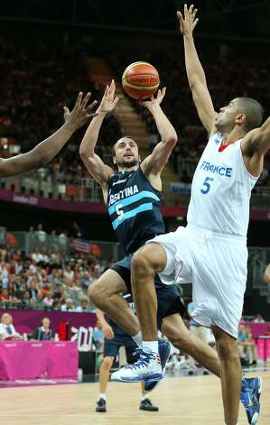 Manu Ginobili #5 of Argentina takes a jump shot in the Men's Basketball Preliminary Round match between France and Argentina on Day 4 of the London 2012 Olympic Games at Basketball Arena on July 31, 2012 in London, England. (Christian Petersen / Getty Images)