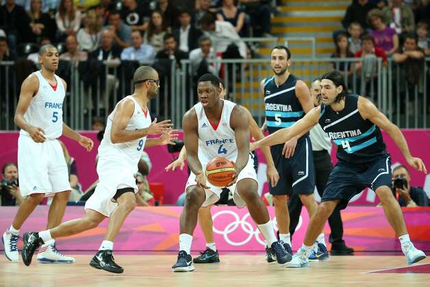 Kevin Seraphin #4 of France passes the ball in the Men's Basketball Preliminary Round match between France and Argentina on Day 4 of the London 2012 Olympic Games at Basketball Arena on July 31, 2012 in London, England. (Christian Petersen / Getty Images)