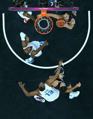 Manu Ginobili #5 of Argentina puts up a shot in the Men's Basketball Preliminary Round match between France and Argentina on Day 4 of the London 2012 Olympic Games at Basketball Arena on July 31, 2012 in London, England. (Ian Walton / Getty Images)