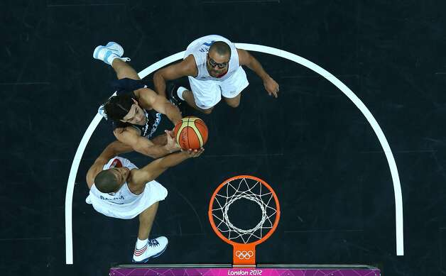 Luis Scola #4 of Argentina  puts up a shot in the Men's Basketball Preliminary Round match between France and Argentina on Day 4 of the London 2012 Olympic Games at Basketball Arena on July 31, 2012 in London, England. (Ian Walton / Getty Images)
