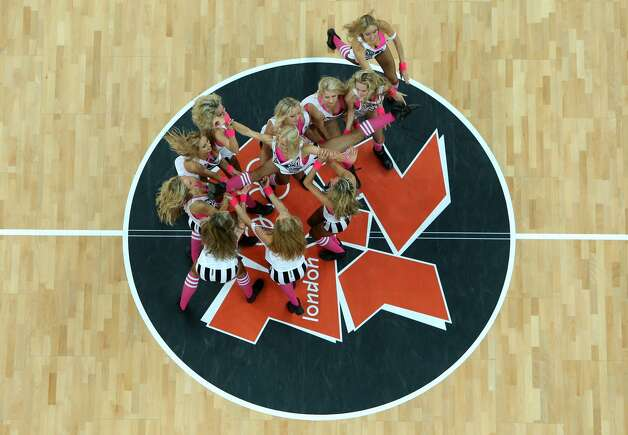 The Red Foxes Dance Group perform during half time of the Men's Basketball Preliminary Round match between France and Argentina on Day 4 of the London 2012 Olympic Games at Basketball Arena on July 31, 2012 in London, England. (Ian Walton / Getty Images)