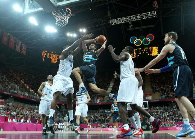 Manu Ginobili #5 of Argentina takes a shot in the Men's Basketball Preliminary Round match between France and Argentina on Day 4 of the London 2012 Olympic Games at Basketball Arena on July 31, 2012 in London, England. (Christian Petersen / Getty Images)
