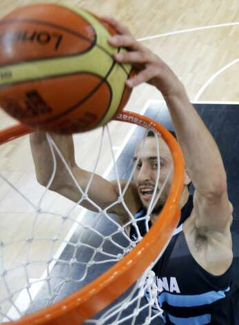 Argentina's Manu Ginobili slams a dunk during a men's basketball game against France at the 2012 Summer Olympics, Tuesday, July 31, 2012, in London. (Charles Krupa / Associated Press)