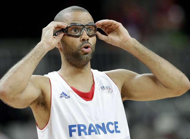 France's Tony Parker adjusts his sports glasses during the first half of a preliminary men's basketball game against Argentina at the 2012 Summer Olympics, Tuesday, July 31, 2012, in London. (Eric Gay / Associated Press)