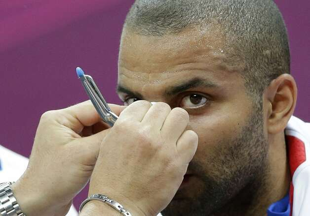 France's Tony Parker has a bandage place on his nose during the first half of a preliminary men's basketball game against Argentina at the 2012 Summer Olympics, Tuesday, July 31, 2012, in London. (Eric Gay / Associated Press)