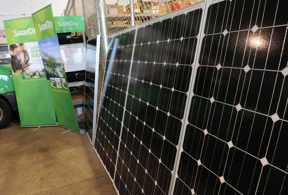 Solar panels lean on a fenced wall during an open house for the new the Solar City office on Vatrano Road on Monday, July 30, 2012 in Albany, N.Y. (Lori Van Buren / Times Union) Photo: Lori Van Buren