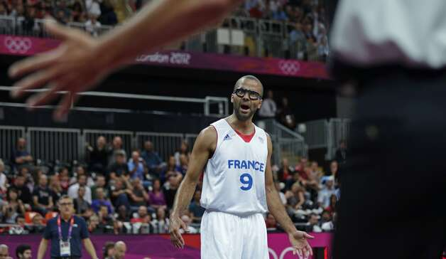 France's Tony Parker argues a call with the referee during a men's basketball game against Argentina at the 2012 Summer Olympics, Tuesday, July 31, 2012, in London. (Charles Krupa / Associated Press)