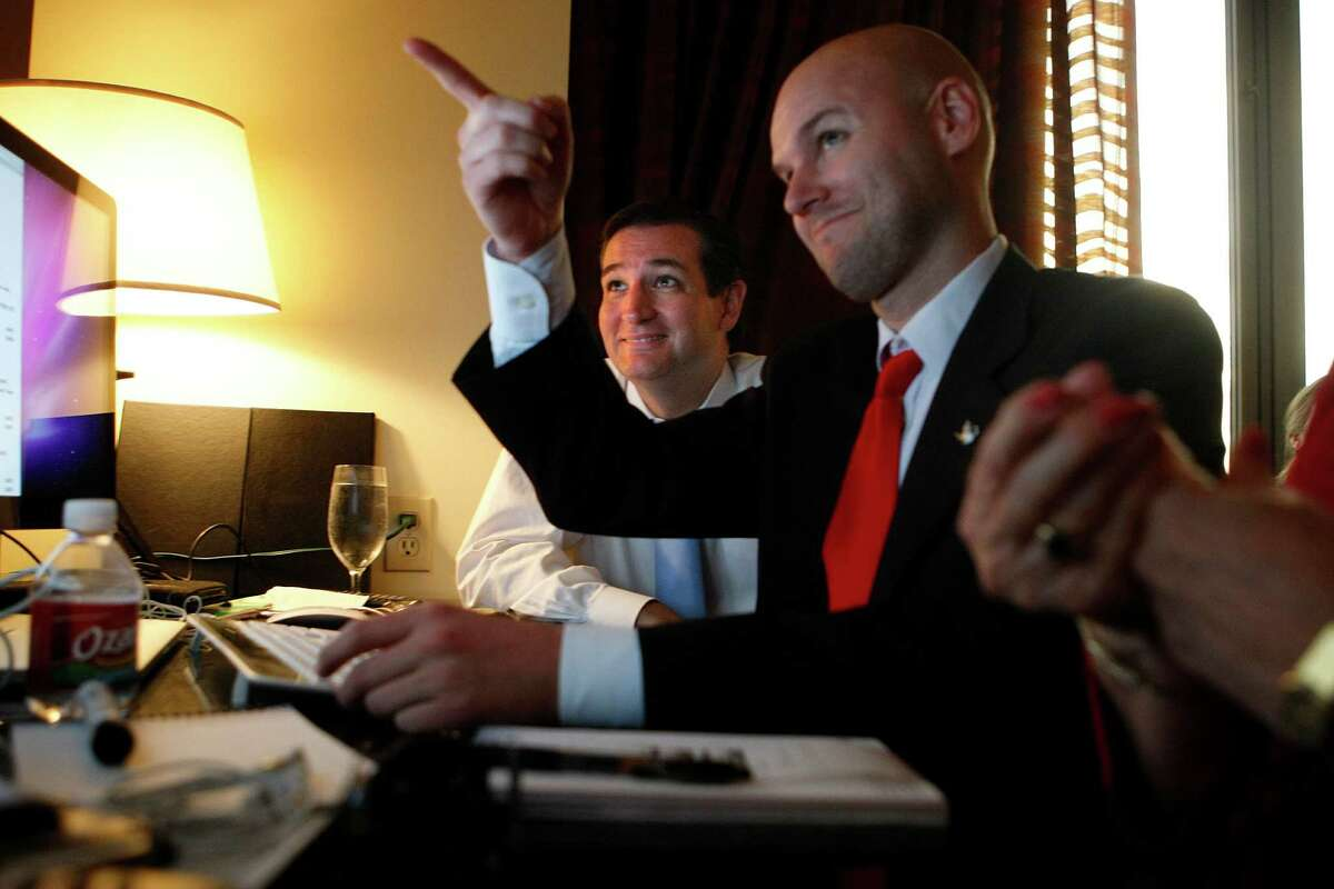U.S. Senator candidate Ted Cruz, left, and his general consultant Jason Johnson look at early returns in his war room at the JW Marriott in the Galleria during his runoff election against rival Republican Lt. Gov. David Dewhurst for the U.S. Senate seat vacated by Kay Bailey Hutchison Tuesday, July 31, 2012, in Houston.