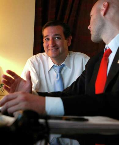 U.S. Senator candidate Ted Cruz, left, and his general consultant Jason Johnson look at early returns in his war room at the JW Marriott in the Galleria as during his runoff election against rival Republican Lt. Gov. David Dewhurst for the U.S. Senate seat vacated by Kay Bailey Hutchison Tuesday, July 31, 2012, in Houston. Photo: Johnny Hanson, Houston Chronicle / © 2012  Houston Chronicle