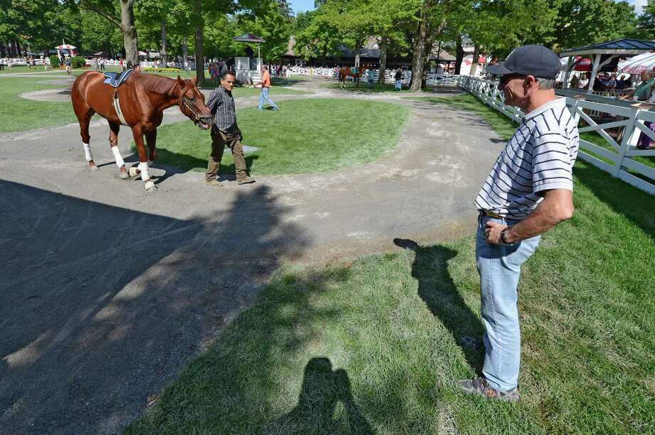 Trainer Eoin Harty keeps a careful eye on Endorsement while getting some schooling in the paddock at the Saratoga Race Course in Saratoga Springs, N.Y. July 29, 2012.  (Skip Dickstein/Times Union) Photo: Skip Dickstein / 00018656A