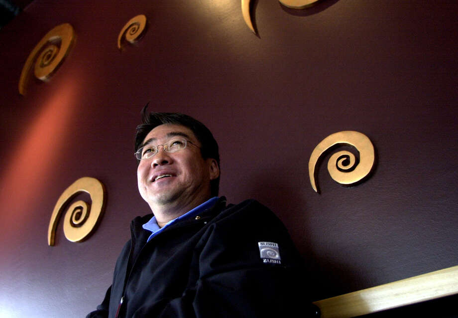 Al Tomita, president of Sushi Zushi, Inc., stands in his newest Sushi Zushi restaurant on 1604 at Stone Oak Parkway on Friday, April 16, 2004. Photo: WENDI POOLE, SPECIAL TO THE EXPRESS-NEWS / SAN ANTONIO EXPRESS-NEWS