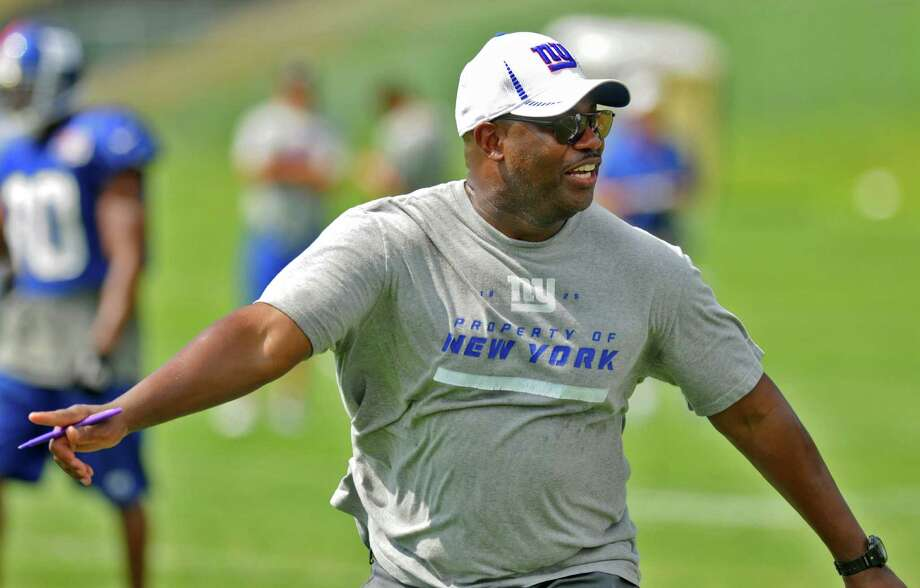 New York Giants defensive coordinator Perry Fewell urges on his players during  a training camp practice at UAlbany on Monday July 30, 2012 in Albany, NY.  (Philip Kamrass / Times Union) Photo: Philip Kamrass / 00018618A
