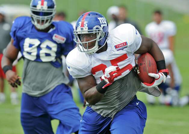 New York Giants running back Andre Brown carries the ball  during  a training camp practice at UAlbany on Monday July 30, 2012 in Albany, NY.  (Philip Kamrass / Times Union) Photo: Philip Kamrass / 00018618A